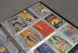 A folder of phone cards