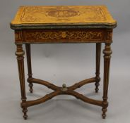 A 19th century style Continental inlaid card table. 70 cm wide.