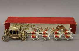 A Lesney boxed Coronation coach. 41 cm long overall.