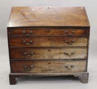 A George III mahogany bureau. 107 cm wide.
