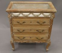 A French vitrine chest. 68.5 cm wide.