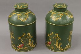 A pair of green toleware tea tins. 36 cm high.