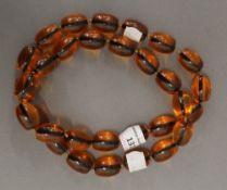 A bead necklace. 82 cm long.