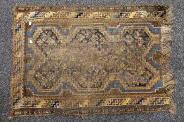 A small antique rug. 105 x 76 cm.