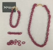 An X jewellery necklace and bracelet.