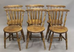 A set of six elm seated stick back kitchen chairs