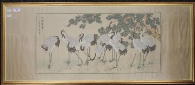 A Chinese embroidered picture of Cranes, framed and glazed. 102 x 41 cm.
