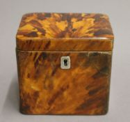 An early 19th century tortoiseshell tea caddy. 11 cm wide.