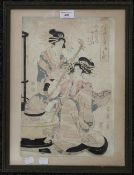 An early 19th century Japanese wood block depicting two ladies, one with a stringed instrument,