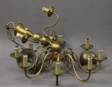 A brass hanging chandelier. 70 cm high.