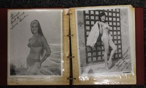 An album containing signed photographs of mid-20th century actresses and pin ups,