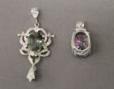 Two silver dress pendants. The largest 6 cm high.