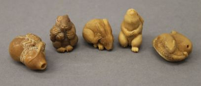 Five nut netsuke. Each approximately 3.5 cm high.