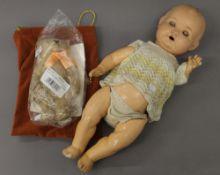 A Steiff William and Catherine Royal Wedding teddy bear and a doll. The bear 25 cm high.