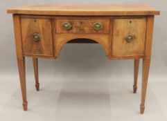 A Victorian inlaid mahogany bow front sideboard. 107 cm wide.
