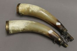 A pair of 19th century horn shot and powder flasks. Each approximately 36 cm long.
