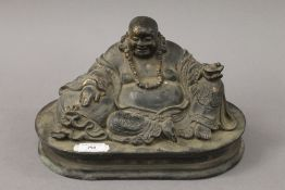 A bronze model of buddha seated. 33 cm wide.