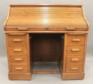 An early 20th century oak roll top desk. 121 cm wide.