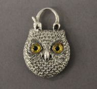 A silver padlock formed as an owl. 2.5 cm wide.