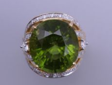 An 18 ct gold tourmaline and multi diamond ring. Ring size O. 15.8 grammes total weight.