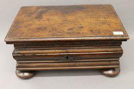 A 17th/18th century Continental walnut box. 50 cm wide.