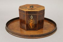 A George III mahogany octagonal tea caddy with shell inlay and a 19th century mahogany oval shell