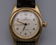 A 14 ct gold cased Rolex Oyster Perpetual Chronometre Bubbleback gentleman's wristwatch. 3.
