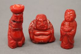 Three carved coral figures. The largest 5.5 cm high.