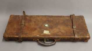 A Victorian leather double shotgun case, the interior bearing label for James Purdey & Sons.