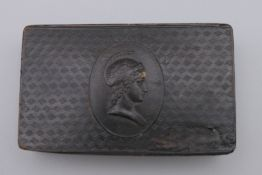 A 19th century horn snuff box centred with a Centurion. 9 cm wide.