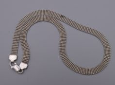 A silver necklace. 39 cm long. 15.5 grammes.