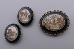 A Victorian micro mosaic brooch/pendant and a pair of micro mosaic studs. The former 3 cm wide.