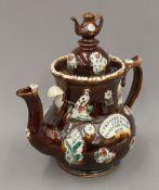 A large Edwardian pottery Barge Ware tea pot. 32.5 cm high.