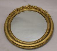 A Victorian gilt framed oval mirror. 100 cm high.