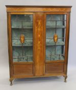 An Edwardian inlaid mahogany display cabinet. 113.5 cm wide x 145 cm high.
