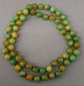 A string of jade beads. 82 cm long.