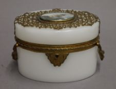 A 19th century French Palais Royale opaline glass and finely worked ormolu oval shaped box with