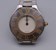 A Must De Cartier wristwatch. 3.75 cm wide.