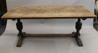 An early 20th century oak refectory table and six chairs. The table 180 cm long.