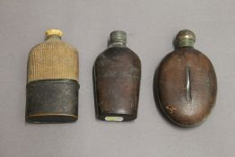 Three hip/spirit flasks. The largest 14 cm high.