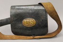 A 19th century United States Army leather bag, with fitted interior and brass badges. 23.5 cm wide.