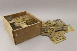 A quantity of late 19th/early 20th century brass printer's stencils
