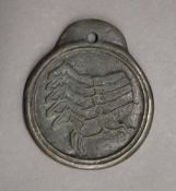 A large Chinese bronze medallion. 11.5 cm high.