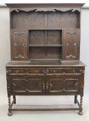 An early 20th century oak dresser. 137 cm wide x 195 cm high.