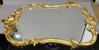 WITHDRAWN A modern gilt framed mirror. 120 cm high.