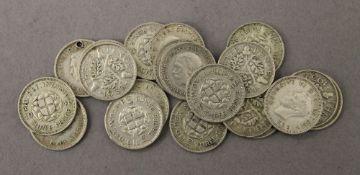 Twenty silver three-pence coins