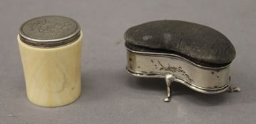 A silver crescent shaped pin cushion, together with a Victorian silver and ivory container.