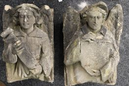 A pair of Antique carved stone corbels formed as angels.