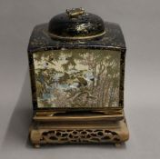 A large Meiji period Satsuma lidded vase of square form, with pierced lid,