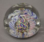 A faceted glass paperweight. 5 cm high.